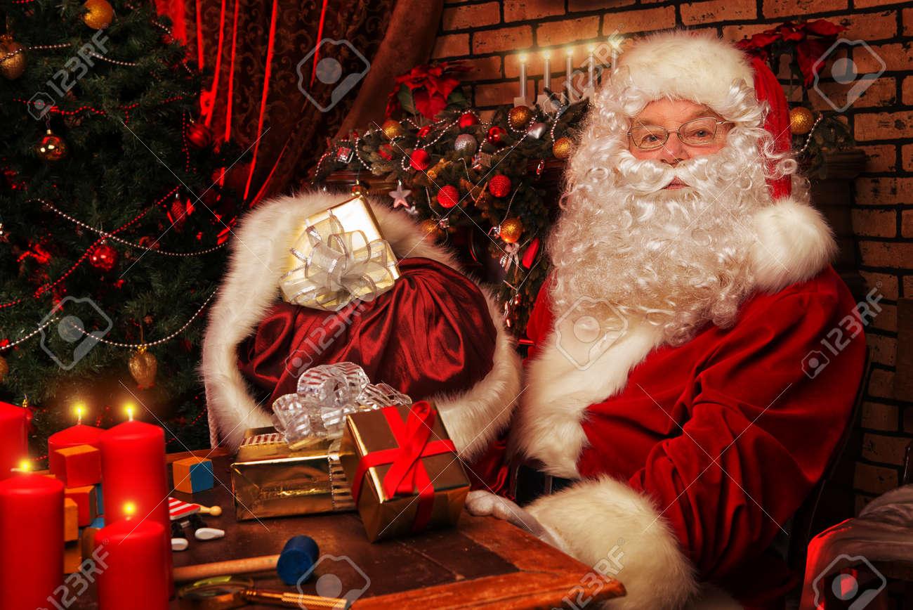 Santa Claus Making Christmas Gifts At Home. Stock Photo, Picture And ...