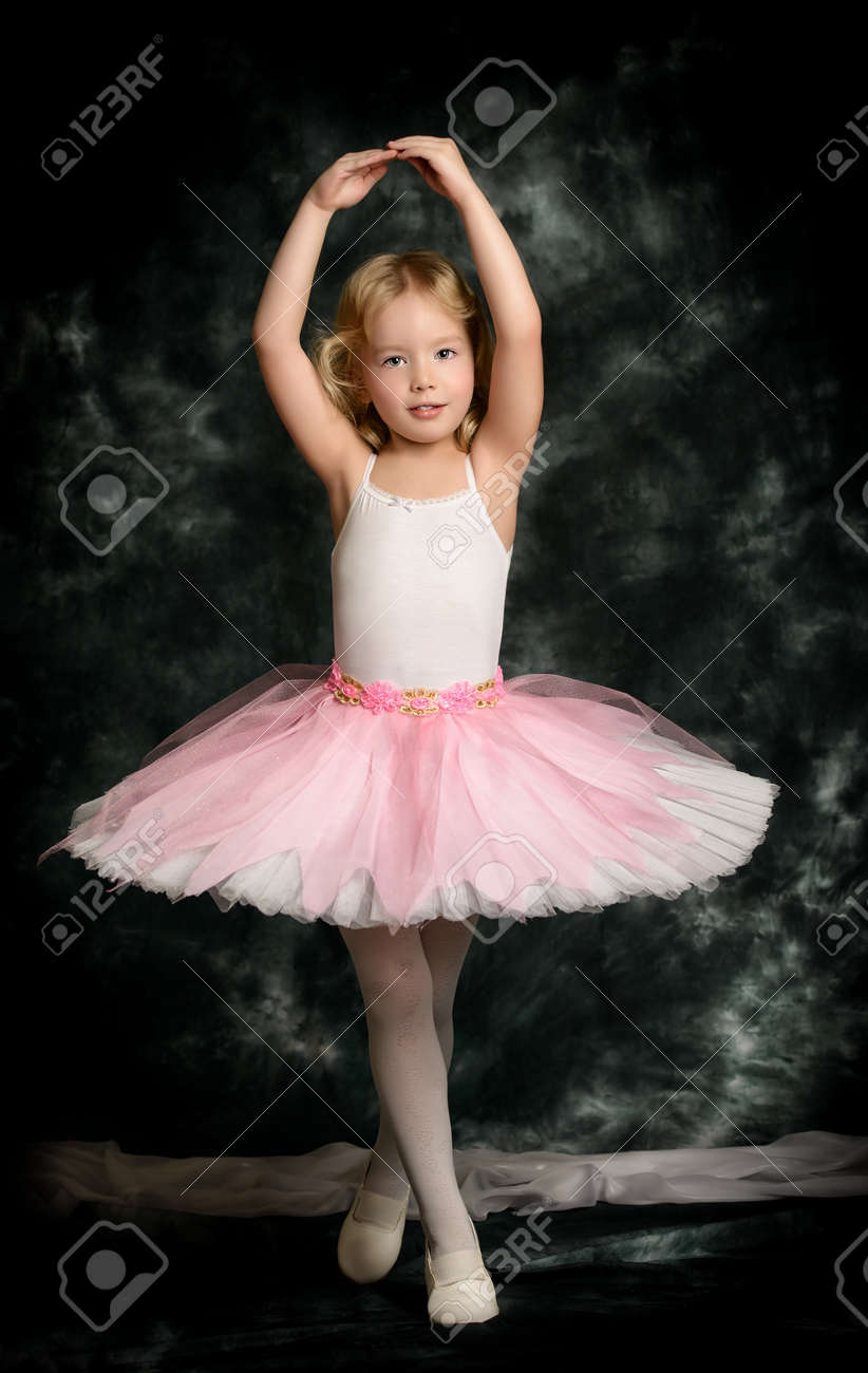 e4cc2764ab05 Pretty Little Girl Ballerina In Tutu Posing Over Vintage . Stock ...