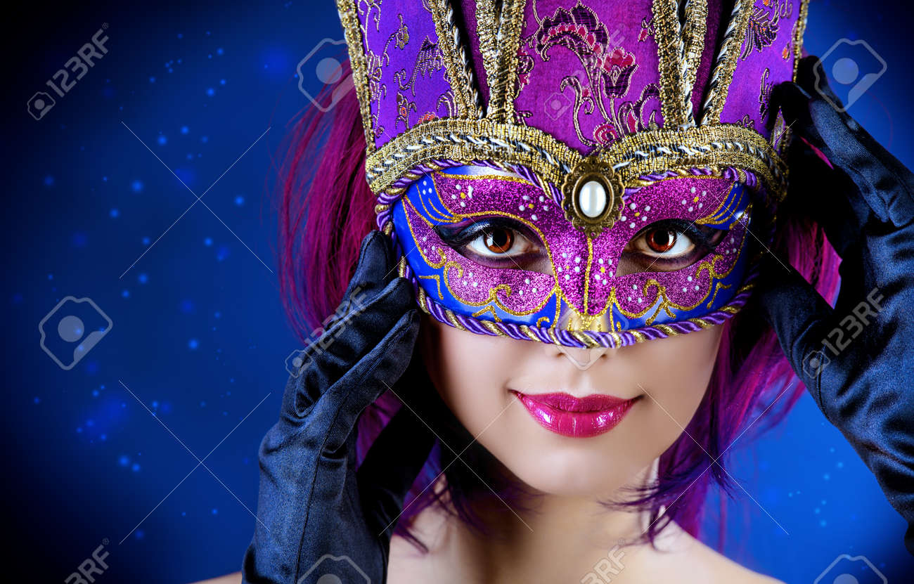 b119d511e603 Beautiful young woman in carnival mask. Masquerade. Dark background. Stock  Photo - 28772431