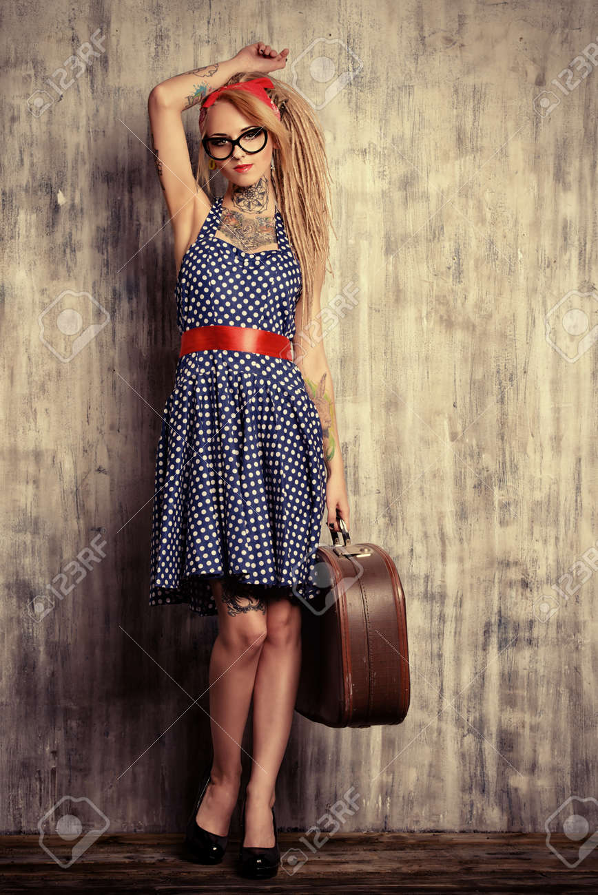 Modern Pin-up Girl In Old-fashioned Polka-dot Dress And Modern ...