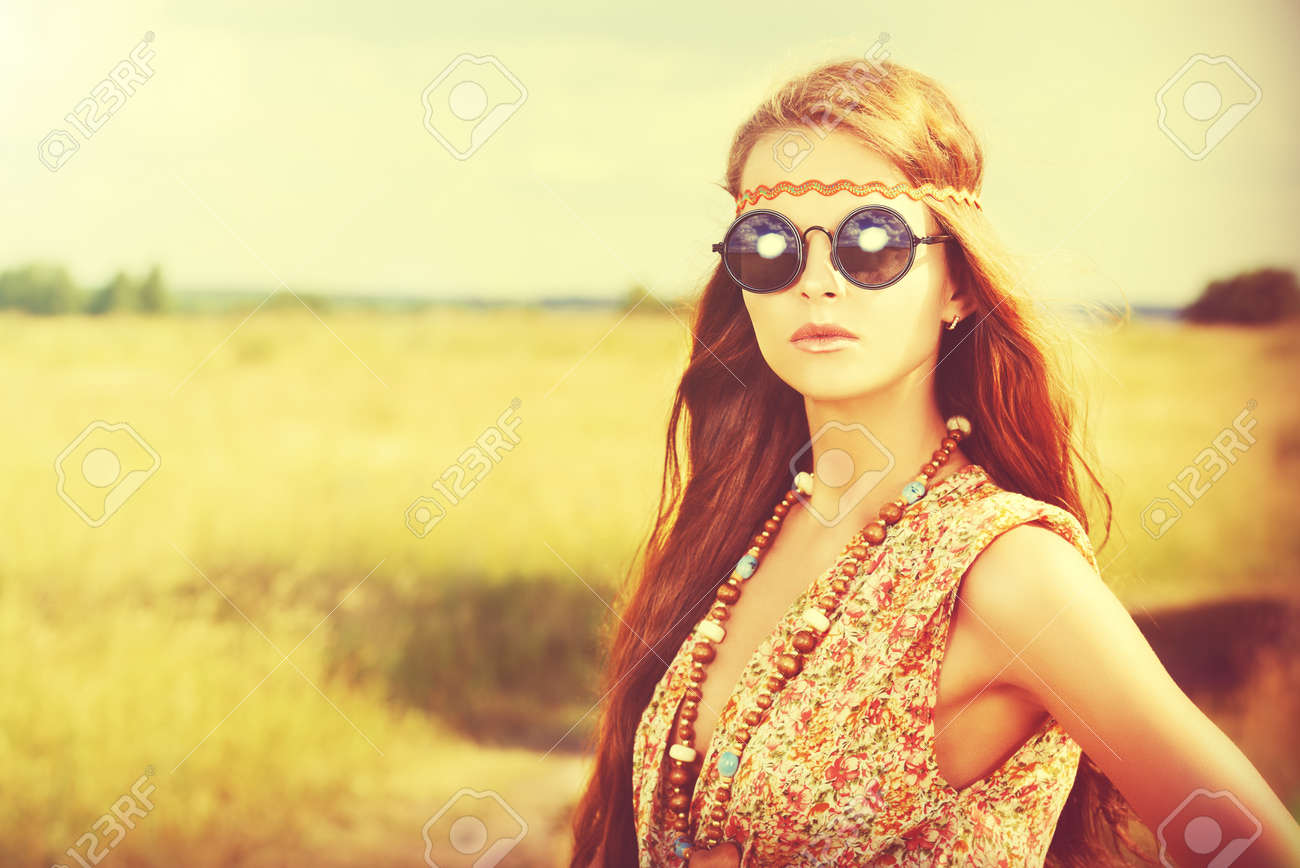 Romantic hippie girl standing in a field Stock Photo - 32091318 d0a7c9d20456