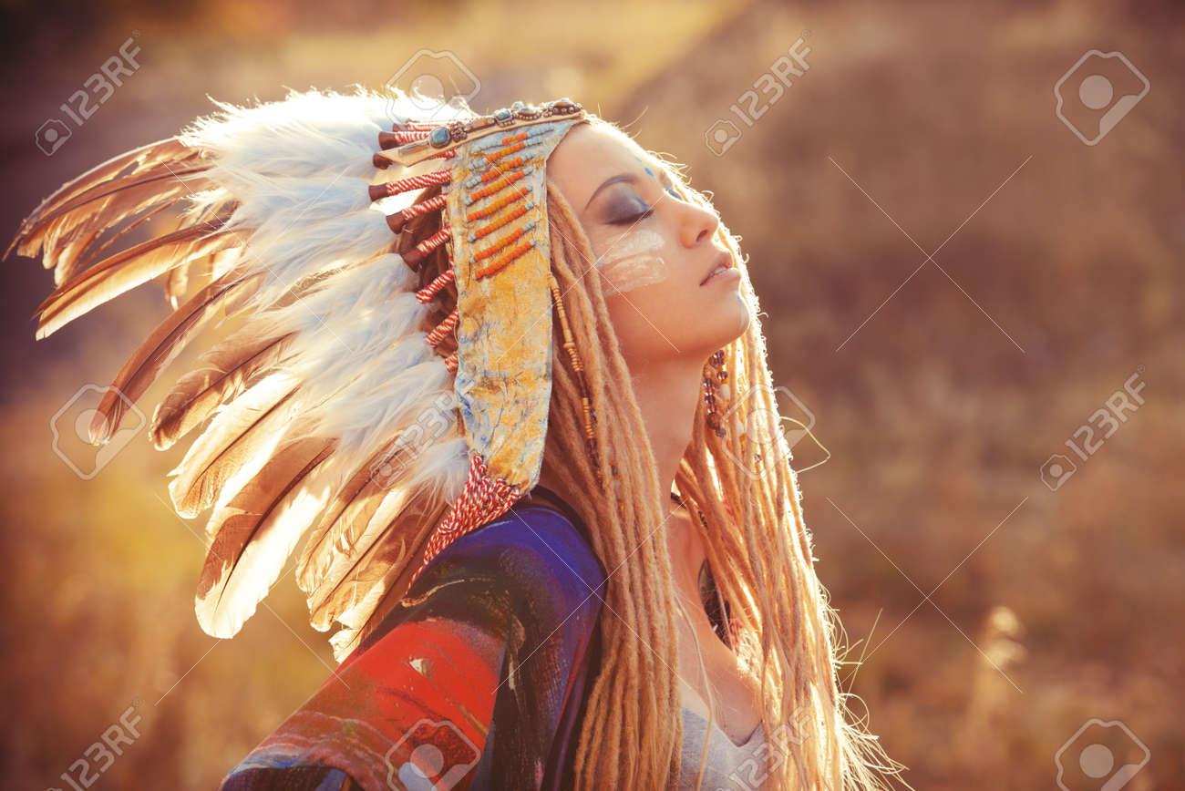 close up portrait of a beautiful wearing native american