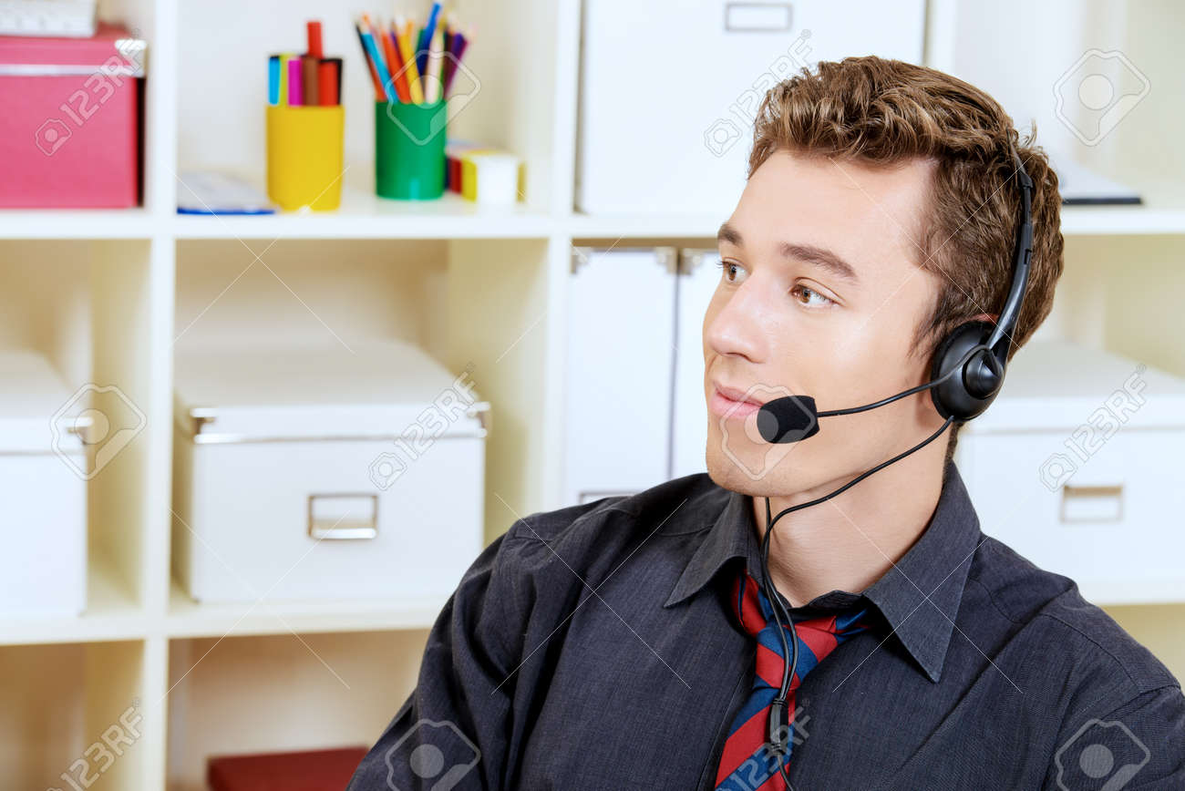 friendly smiling young man customer service worker call center friendly smiling young man customer service worker call center male operator phone headset working
