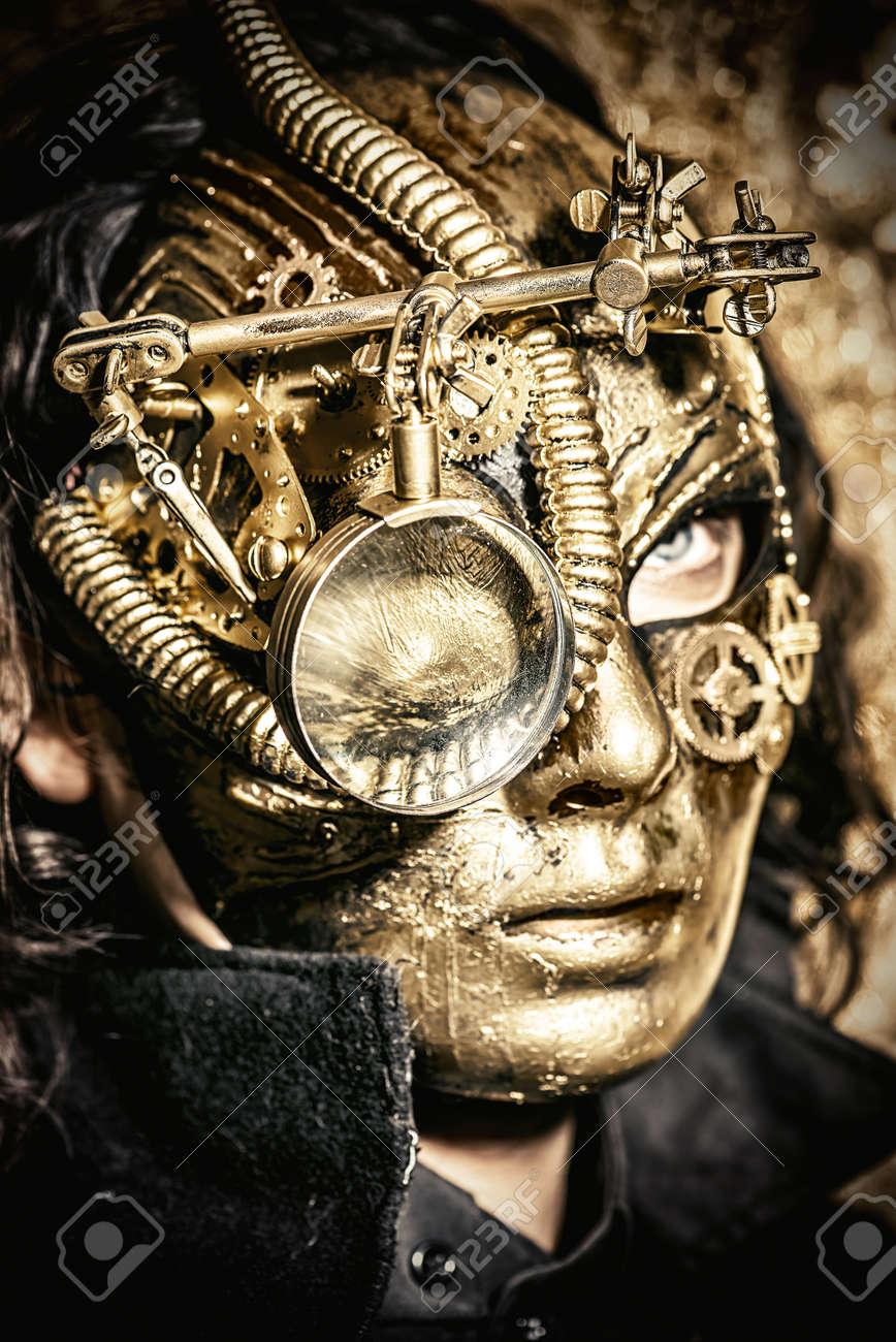 steampunk man wearing mask with various mechanical devices stock