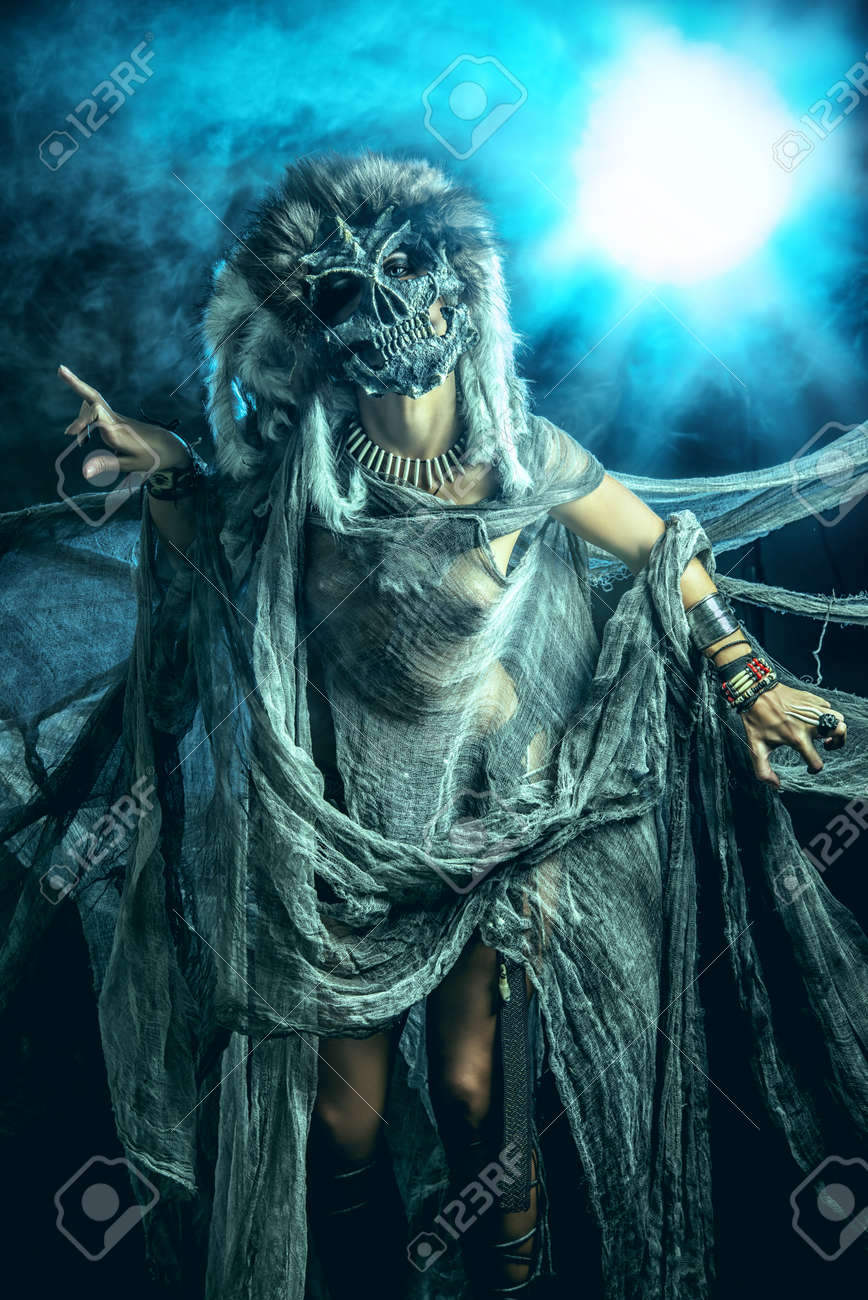frightening female wearing mask of skull fantasy halloween witchcraft voodoo dances