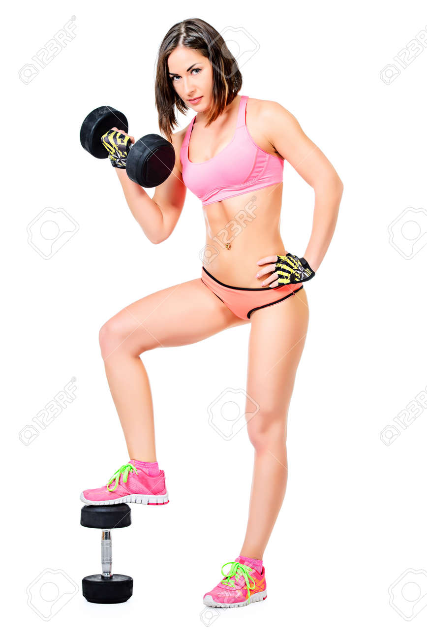 Full Length Portrait Of A Fitness Woman Posing With Dumbbells
