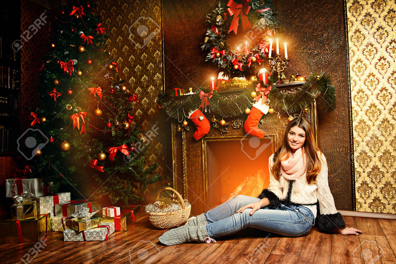 Beautiful Smiling Girl Warms By The Fireplace In The Cozy ...