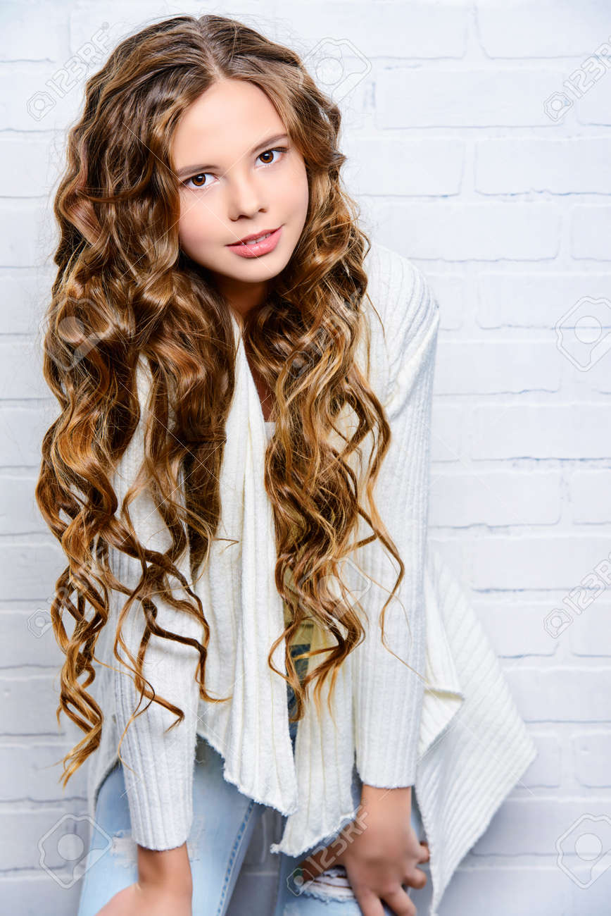 Lovely Teenager Girl With Beautiful Long Curly Hair Wears White