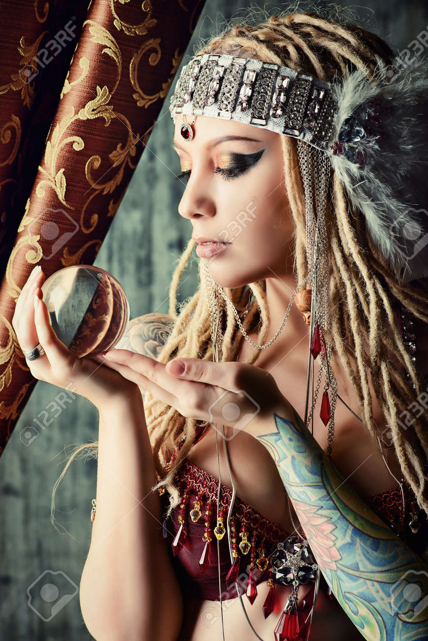 magnificent fortune teller holding crystal ball divination stock