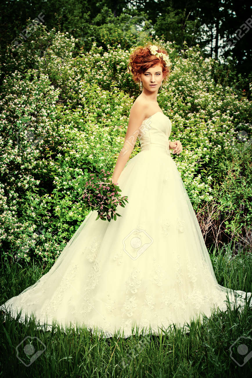 Lovely Elegant Redhaired Bride Stands On The Lawn Wedding Dress And Accessories: Wedding Dress With Red Accesories At Websimilar.org