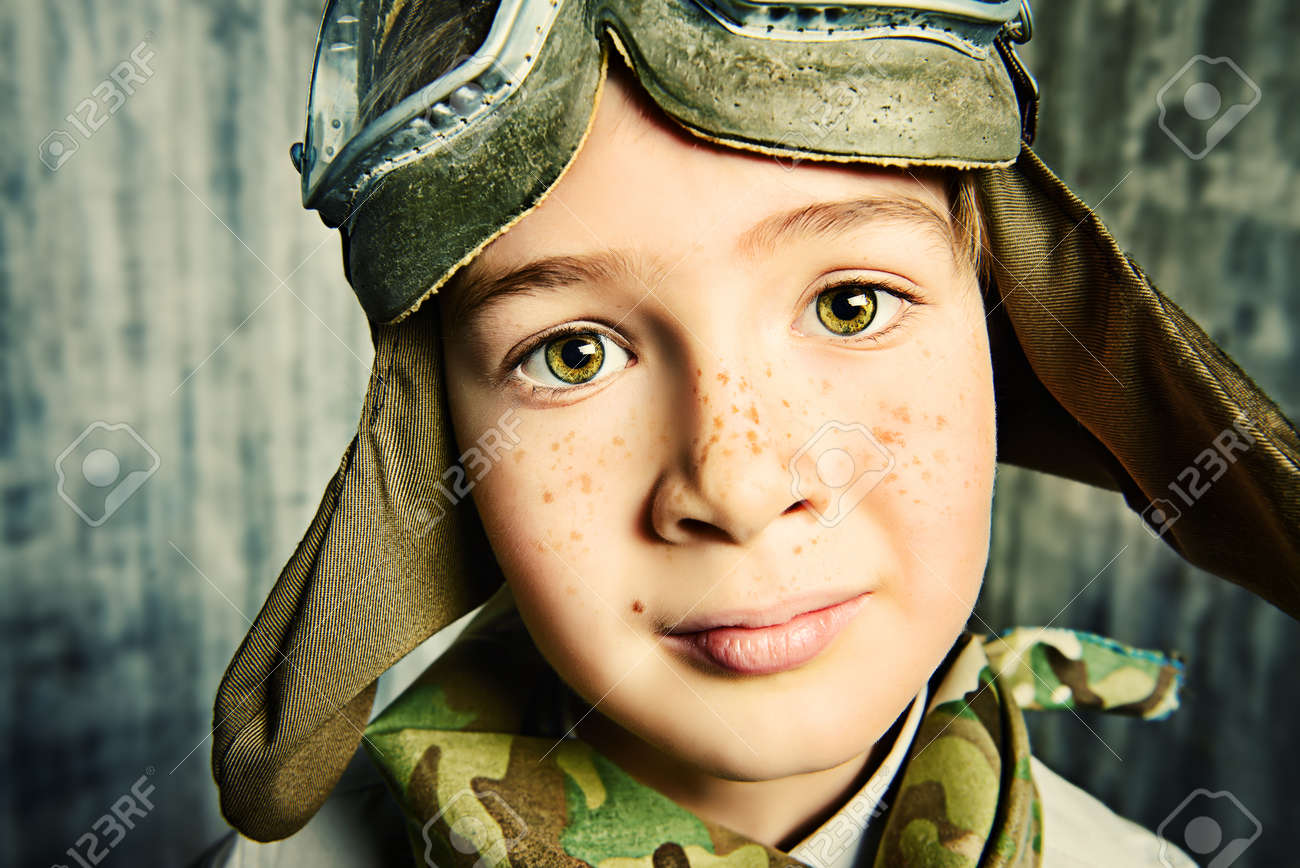 Close up portrait of a happy kid who dreams of becoming a pilot childhood
