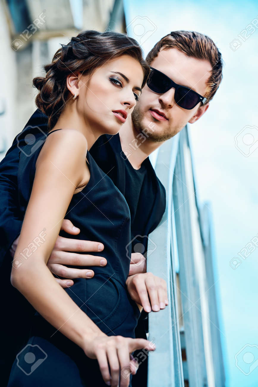 Fashion style photo of a beautiful couple over city background stock photo 43650173