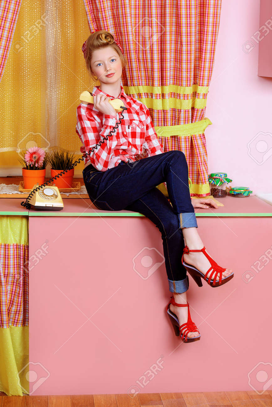 5df12b738ae1 Pretty Teen Girl Talking On The Phone On A Pink Kitchen. Beauty ...
