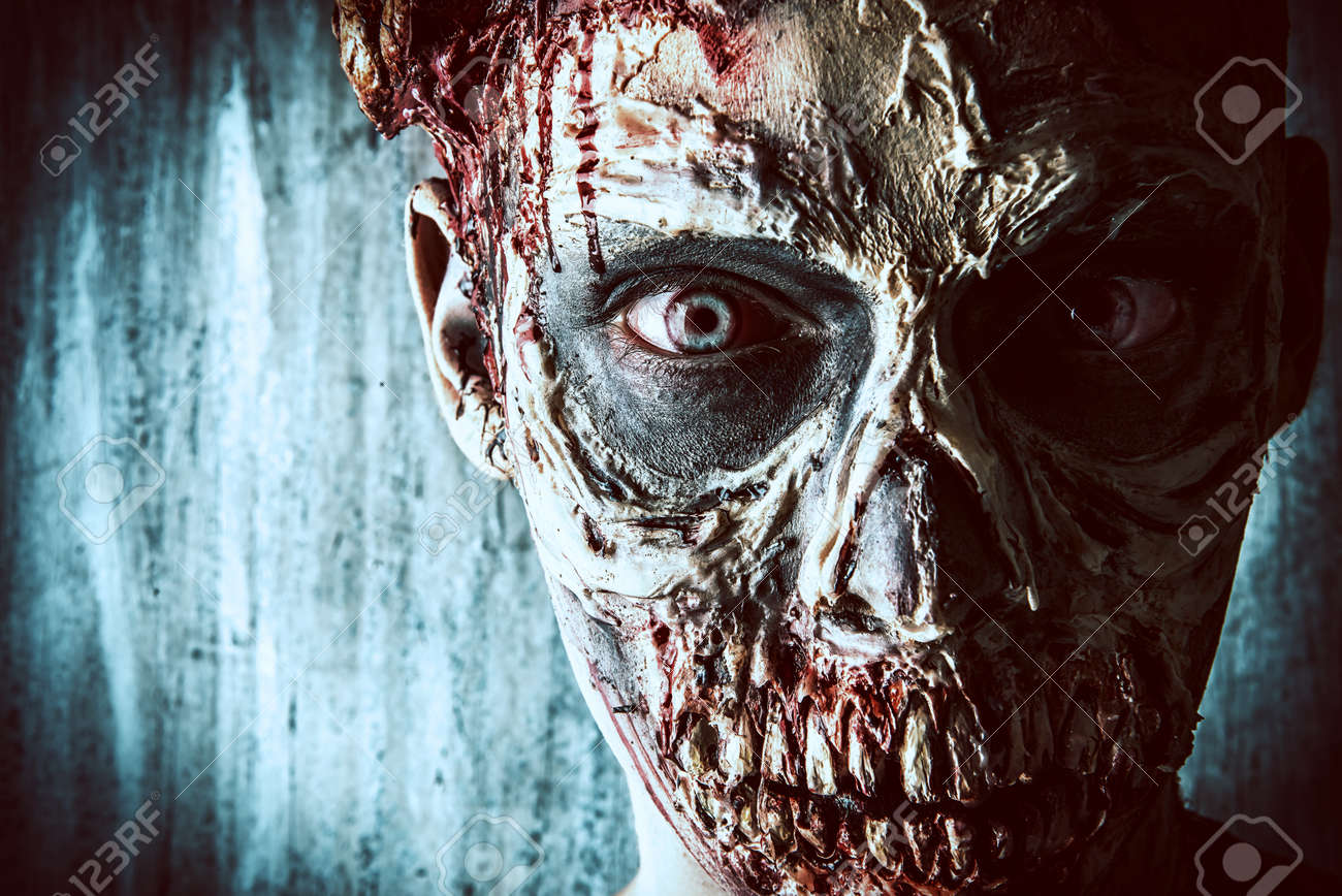 Close-up portrait of a horrible scary zombie man. Horror. Halloween. Stock Photo - 44253312