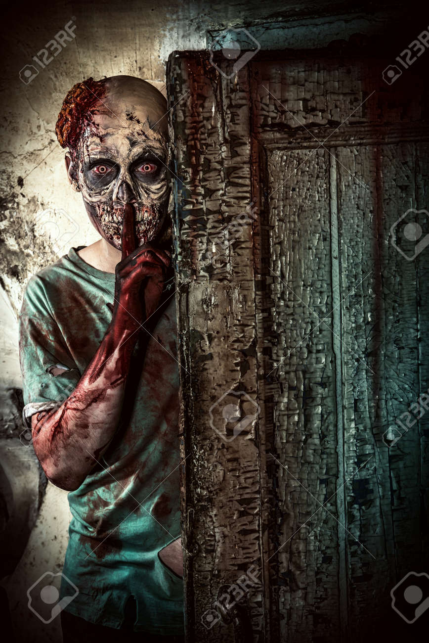 Horrible scary zombie man on the ruins of an old house. Horror. Halloween. Stock Photo - 44513085