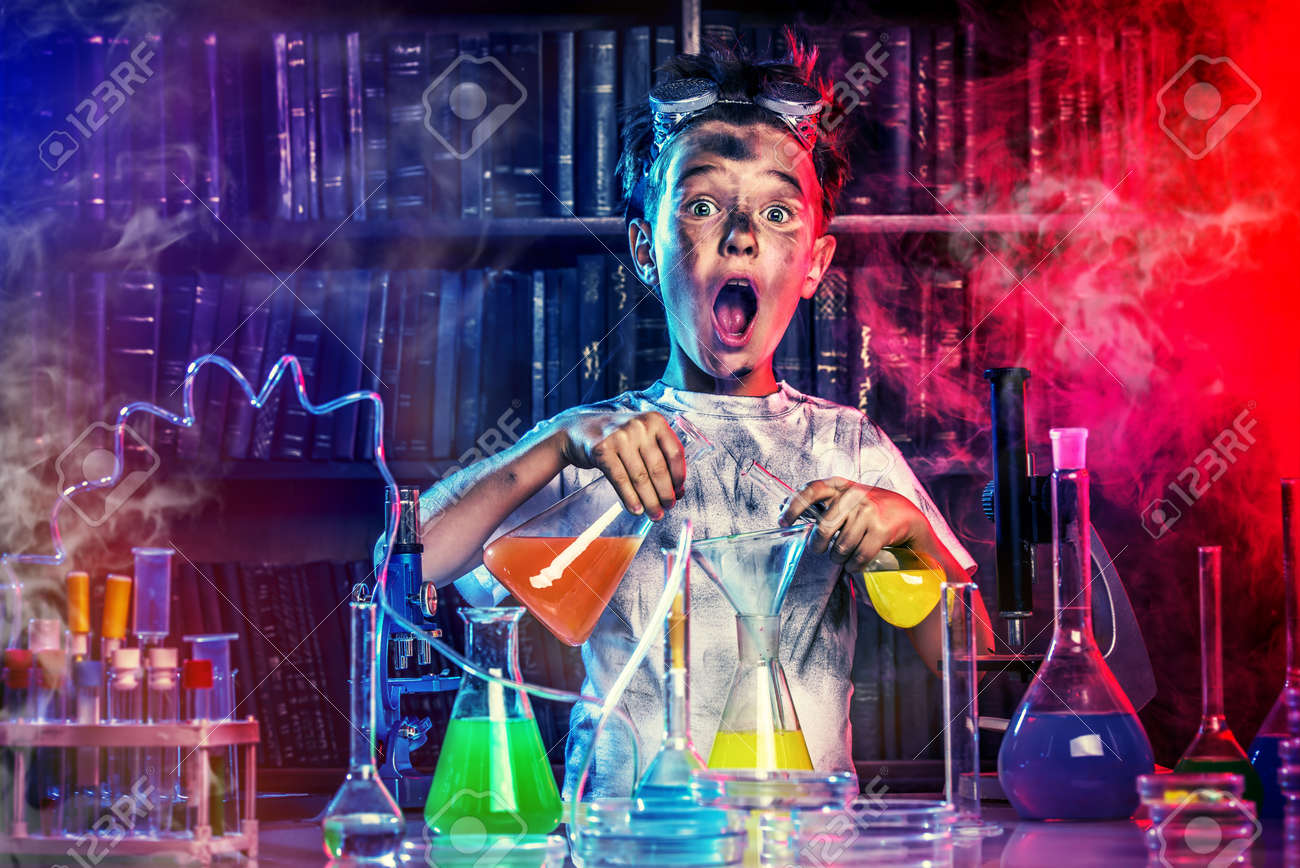 A boy doing experiments in the laboratory. Explosion in the laboratory. Science and education. Stock Photo - 44696348