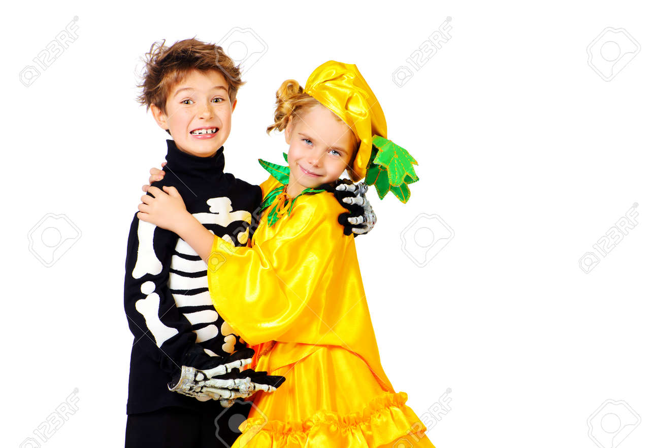 cute boy and a girl wearing halloween costumes posing together stock photo 45250634