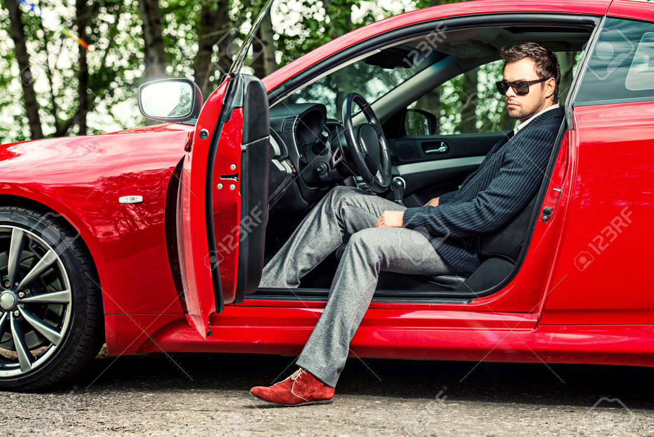 Handsome Young Man In His New Sports Car. Stock Photo   45338595