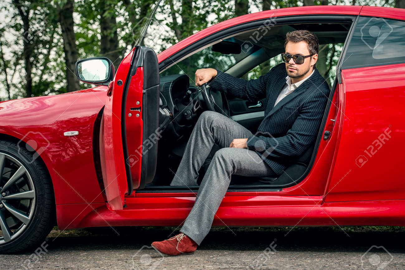 Handsome young man in his new sports car. Stock Photo - 45663083