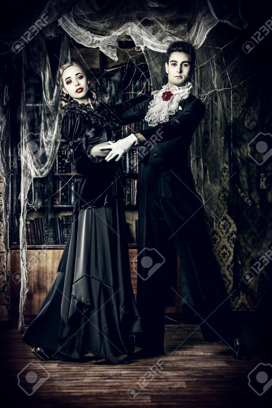 Beautiful Man And Woman Vampires Dressed In Medieval Clothing Dancing A Room Of The Old