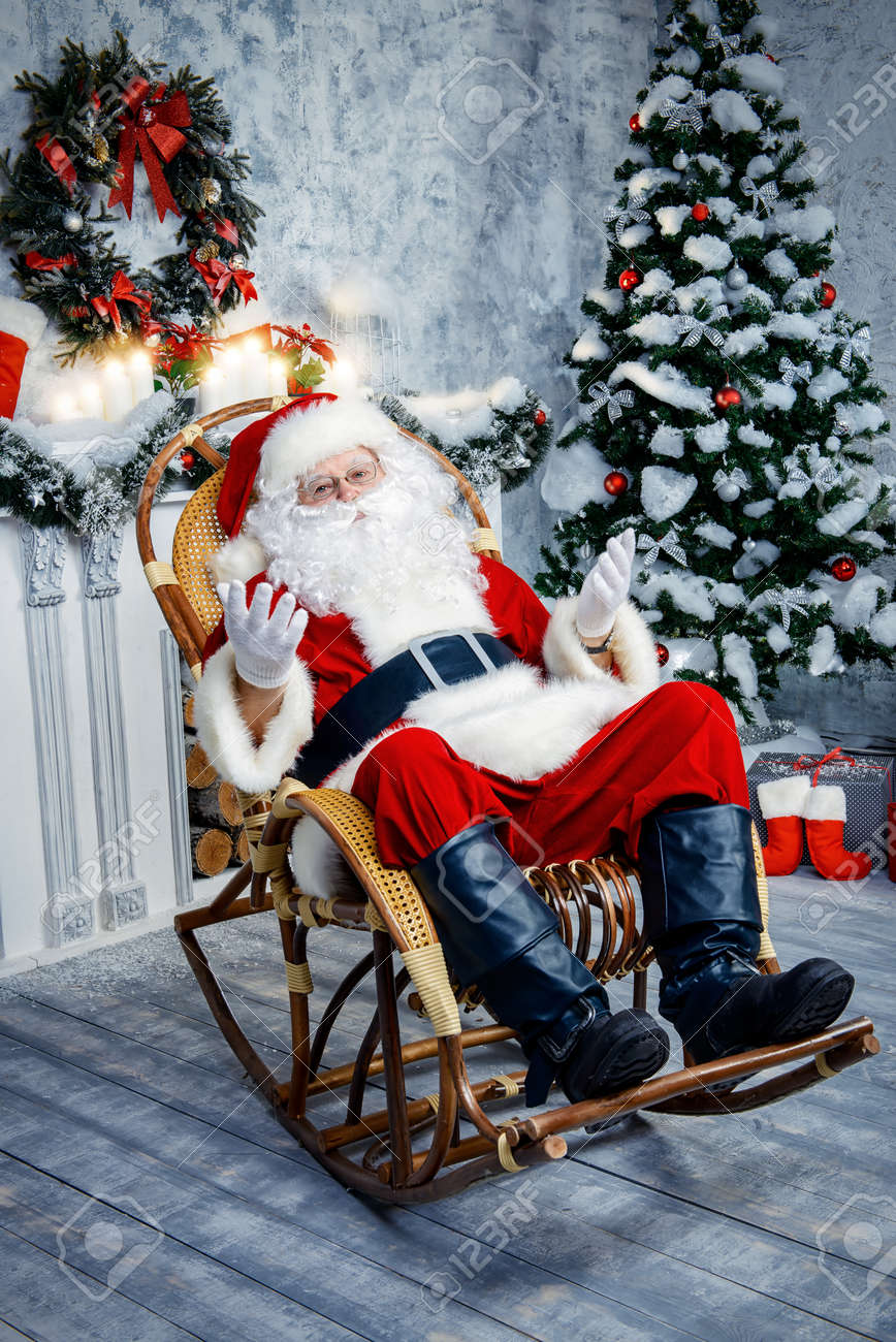 Awesome Good Old Santa Claus Sitting In A Rocking Chair In The Room By Machost Co Dining Chair Design Ideas Machostcouk