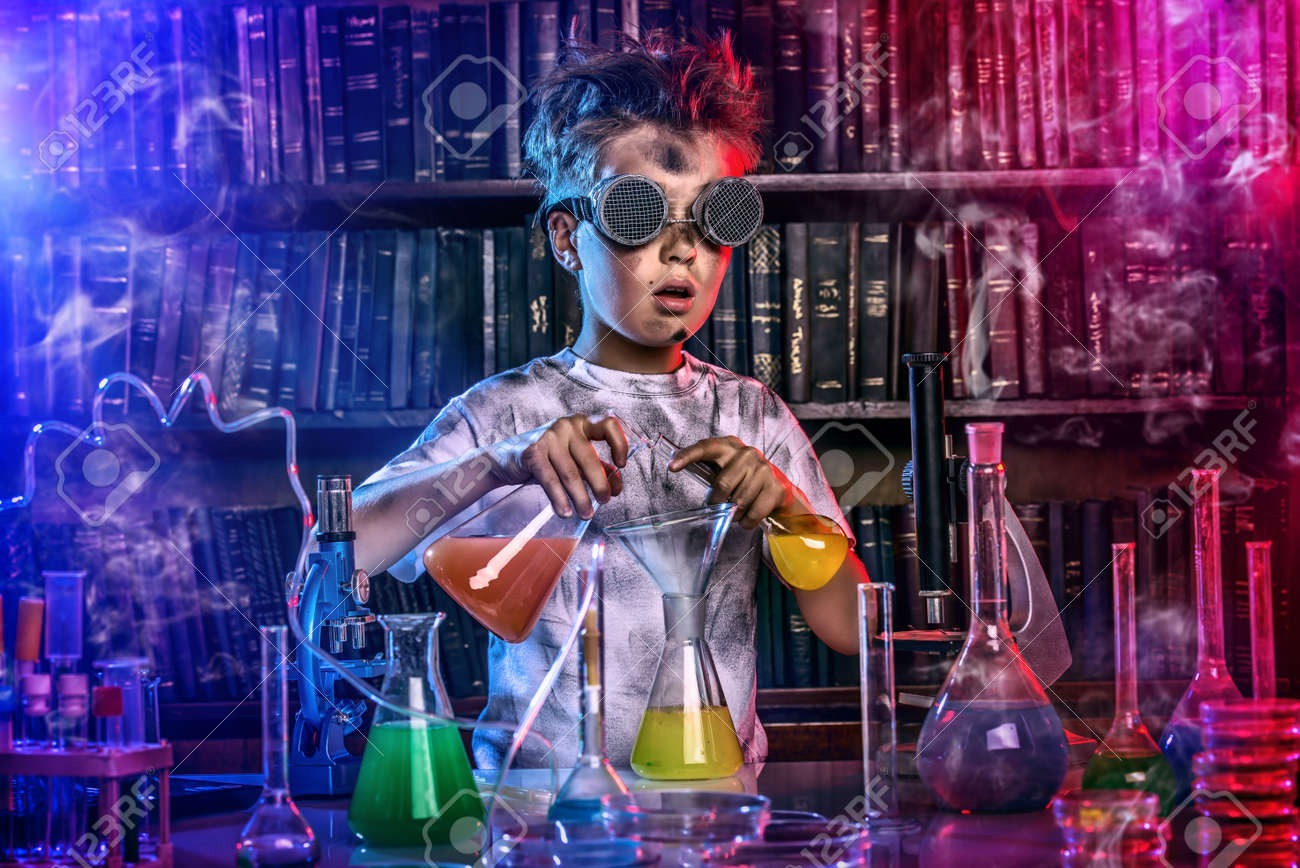 A boy doing experiments in the laboratory. Explosion in the laboratory. Science and education. - 51504143