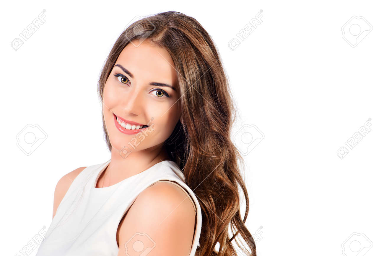 Positive young woman in white dress smiling at camera. Isolated over white background. Beauty concept. Healthy teeth. Cosmetics. Stock Photo - 52480696