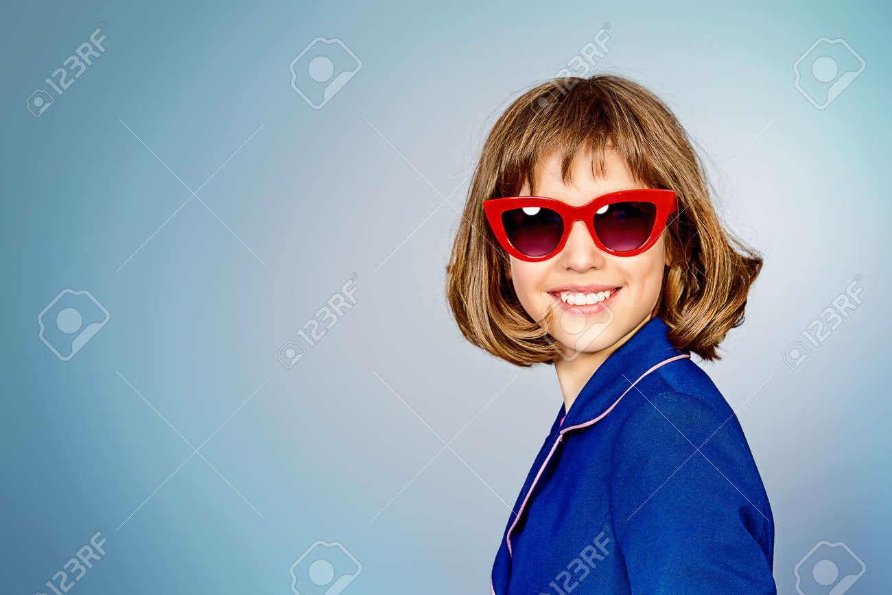 5133eade497c Stylish teen girl wearing pin-up glasses. Children s fashion. Stock Photo -  53975582