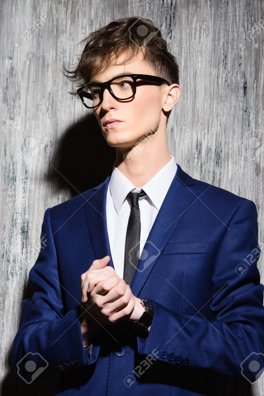 young stylish man with fashionable haircut wearing elegant suit