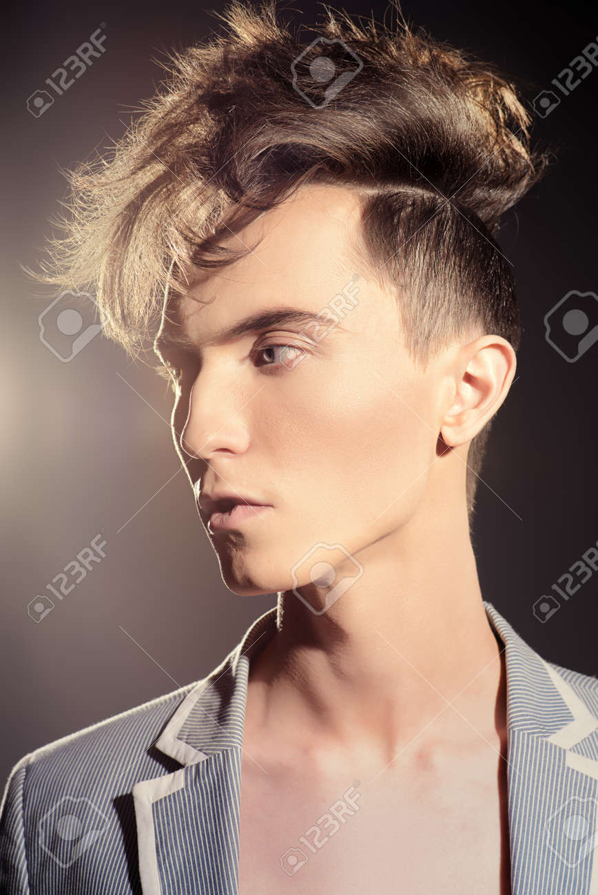 Male hairstyle concept. Fashionable young man with stylish hair. Beauty, fashion. - 56190166