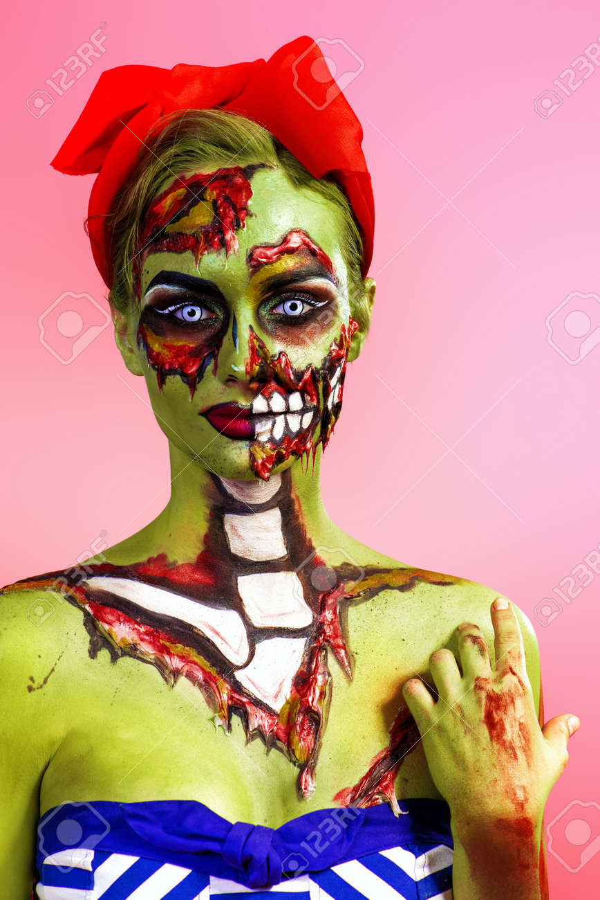 Portrait Of A Pin Up Zombie Woman Over Pink Background Body Painting