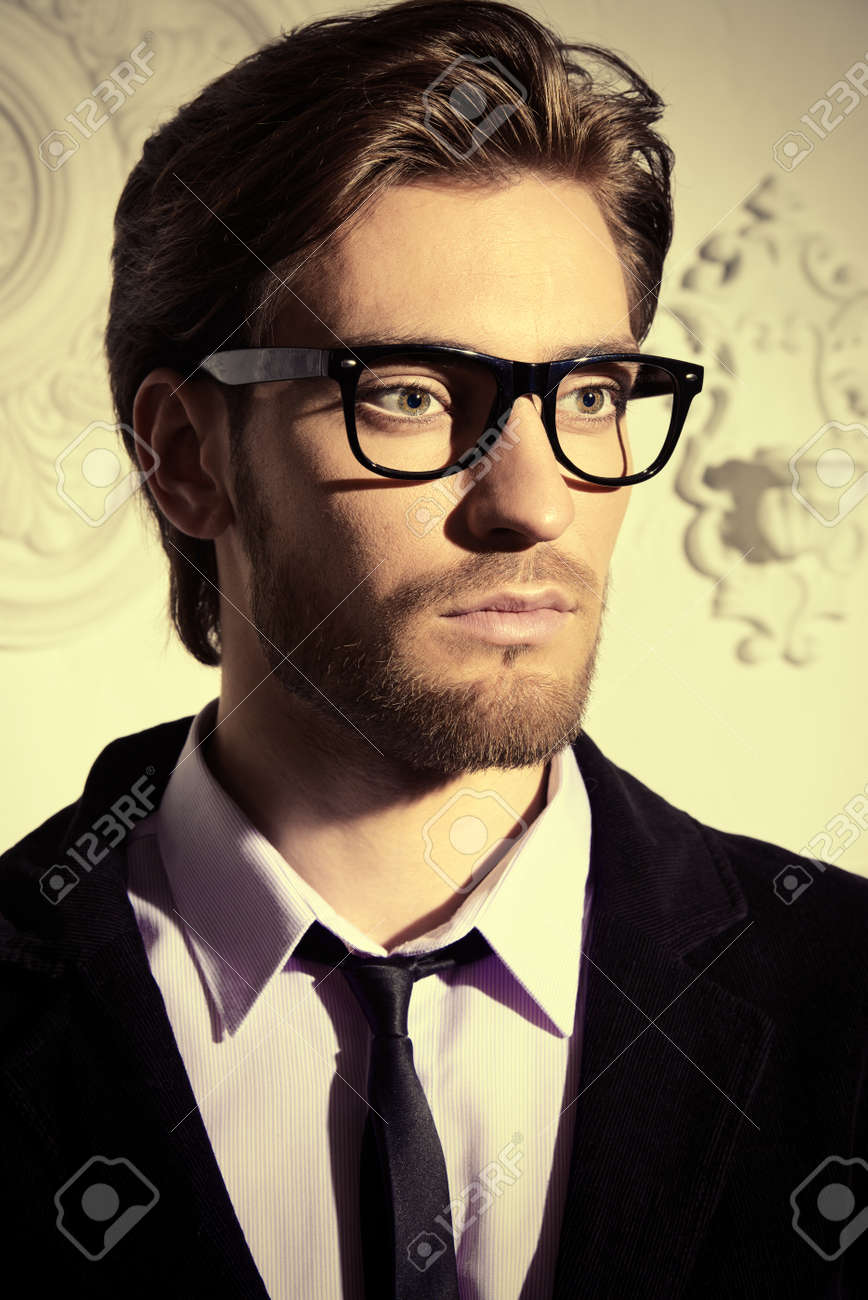 d21712f21 Handsome respectable middle-aged man in glasses. Men's beauty. Optics  style. Stock