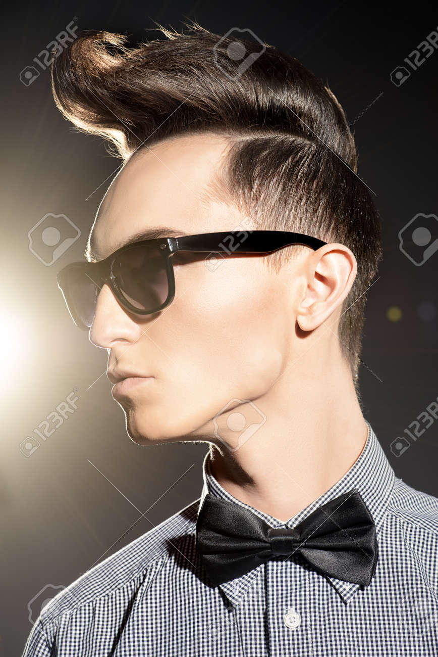 Fashion Studio Shot Of A Handsome Male Model With Stylish Hair