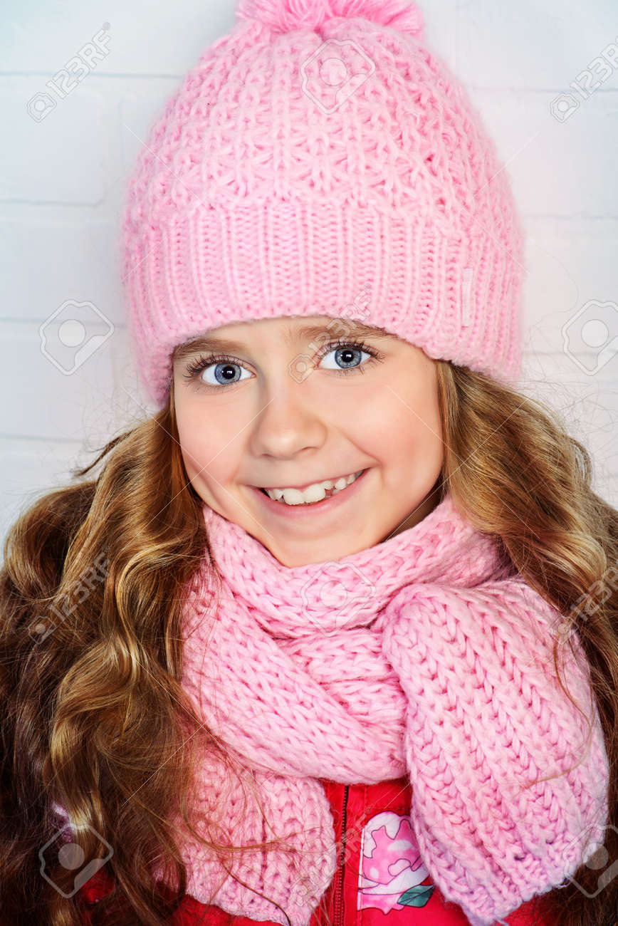 35265bf69 Winter Clothes Concept. Pretty Smiling Girl With Long Curly Hair ...