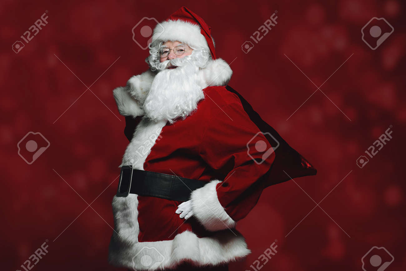 Christmas Concept. Portrait Of A Fairytale Santa Claus Over Red ...