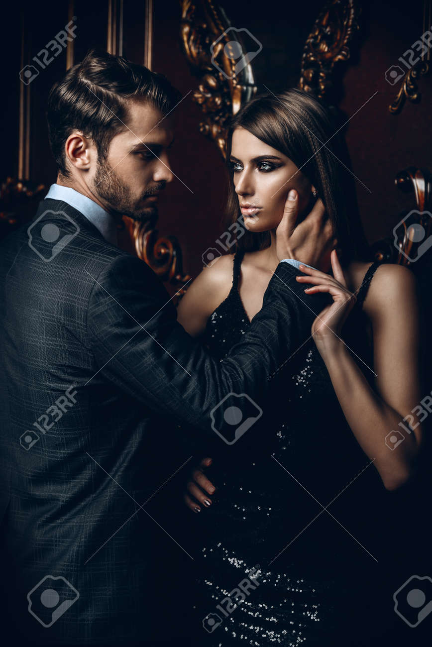 Sexual passionate couple in elegant evening dresses. Luxurious interior. Fashion shot. - 95003175
