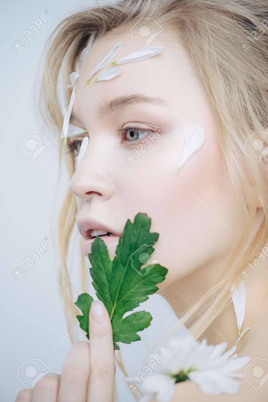 Beautiful Young Woman With Petals Of Chrysanthemum On Face Beauty