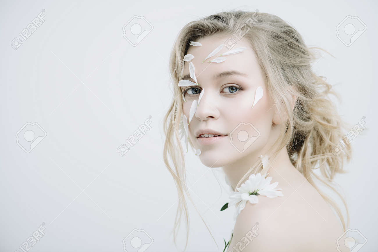 Beautiful Young Woman With Petals Of Chrysanthemum On Face And
