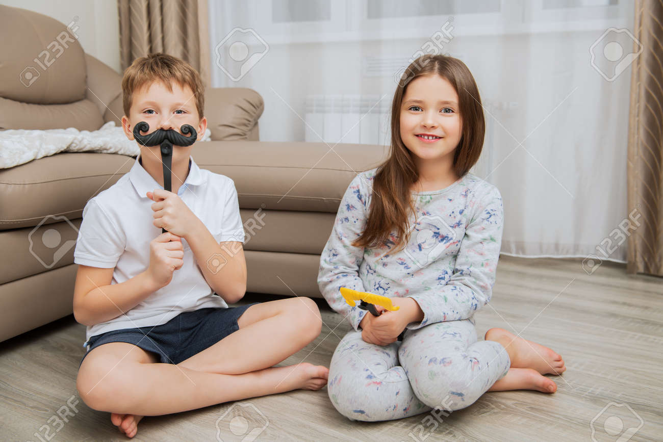 Cute girl and boy are having fun and playing games at home. Childhood. Kid's fashion - 116619988