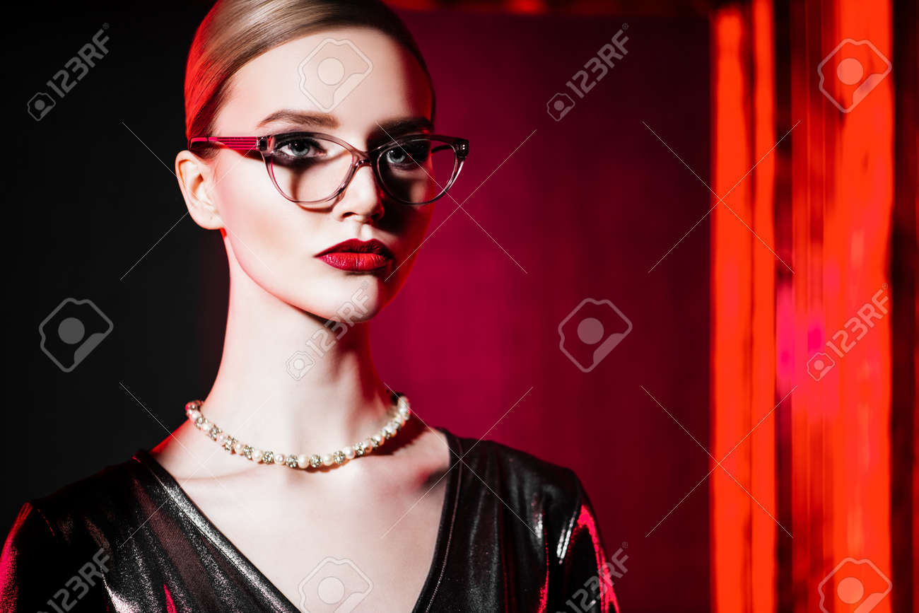 A close up portrait of a confident lady wearing glasses. Beauty, make-up, style. - 123006148