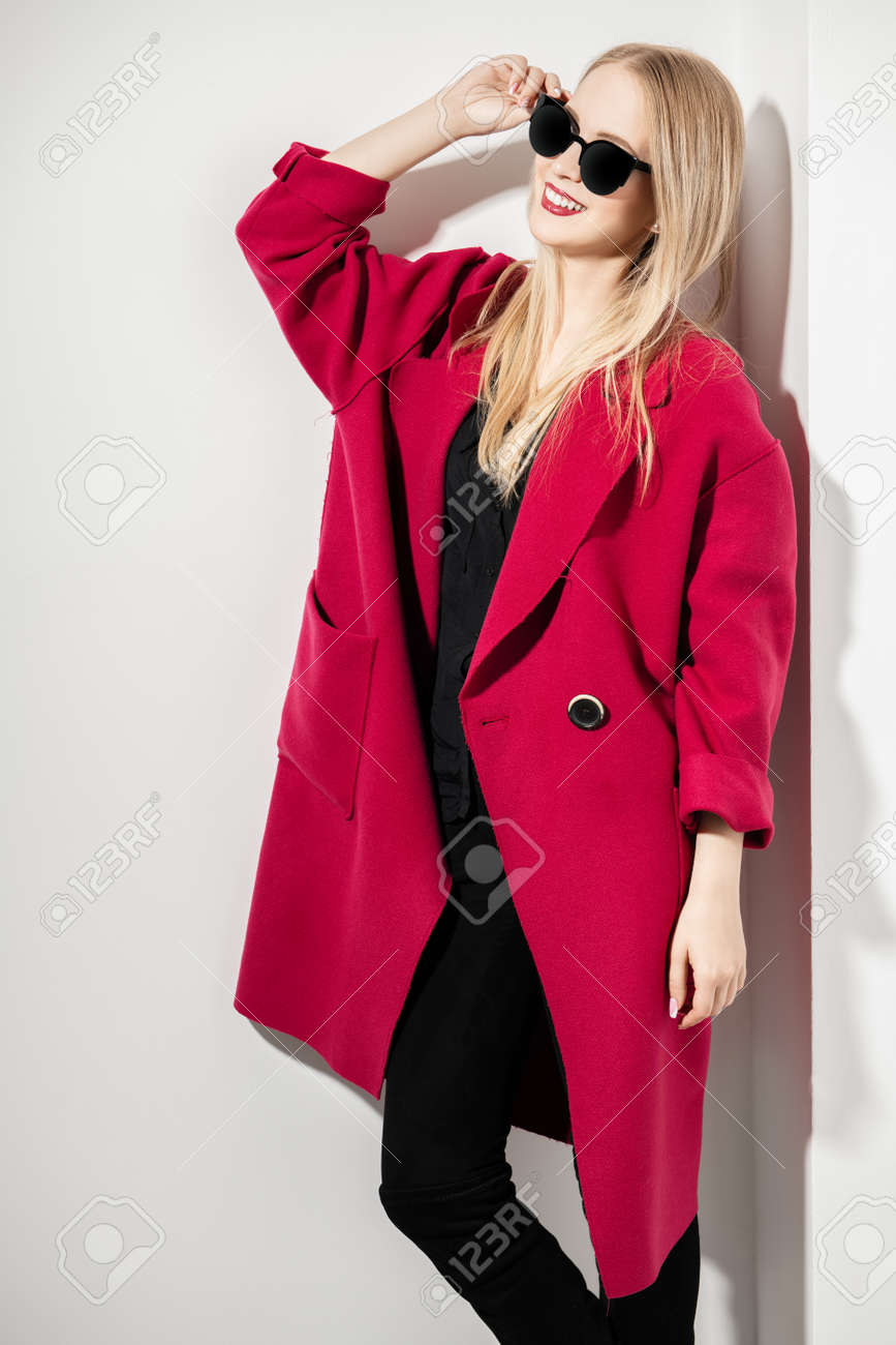 A portrait of a fashionable young lady posing in the studio over the white background. Beauty, fashion, style. - 122591790