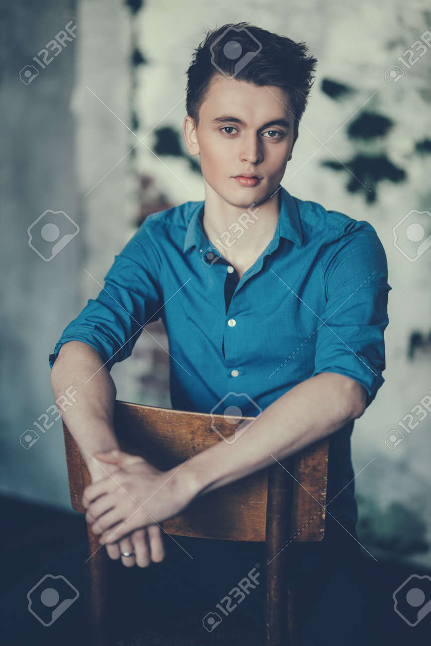 A Portrait Of A Handsome Young Man Wearing A Blue Shirt And Posing Stock Photo Picture And Royalty Free Image Image 124620690