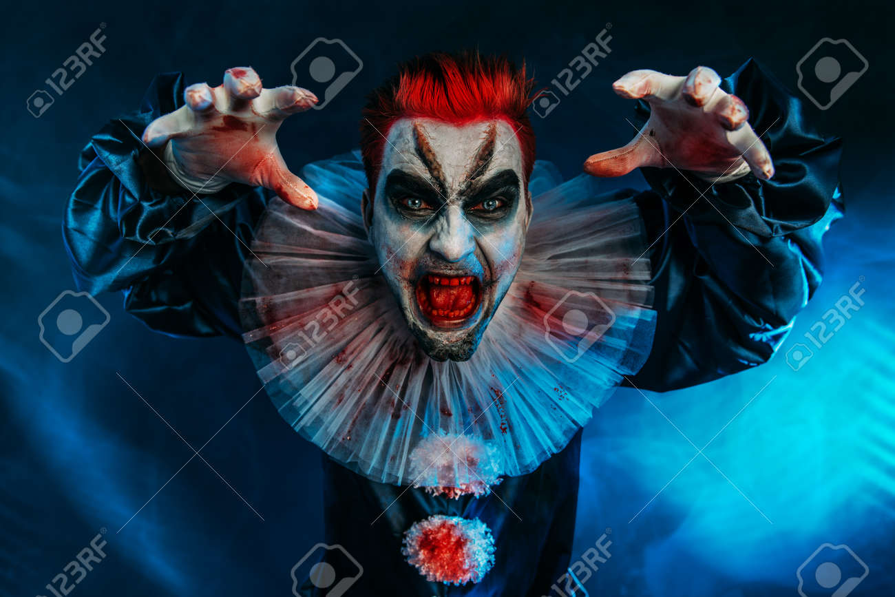 A portrait of an angry crazy clown from a horror film. Halloween, carnival. - 128230873