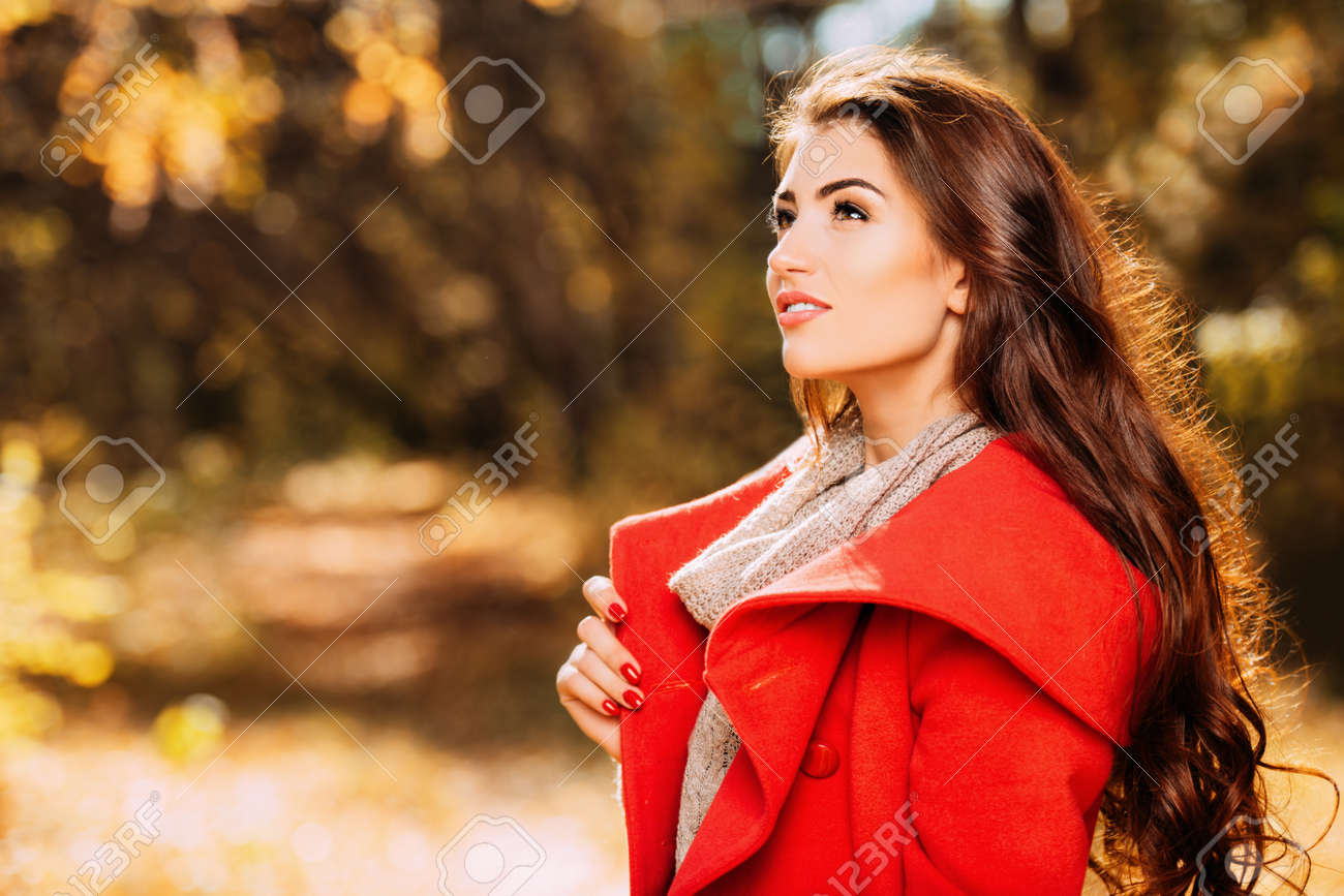 A portrait of a beautiful young woman in an autumn forest. Lifestyle, autumn fashion, beauty. - 128744778