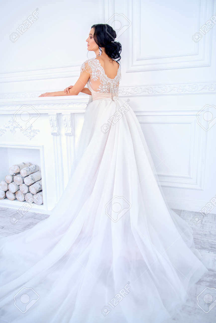 Full length portrait of a beautiful bride woman in elegant pale apricot wedding dress. Luxurious apartments. - 138725436