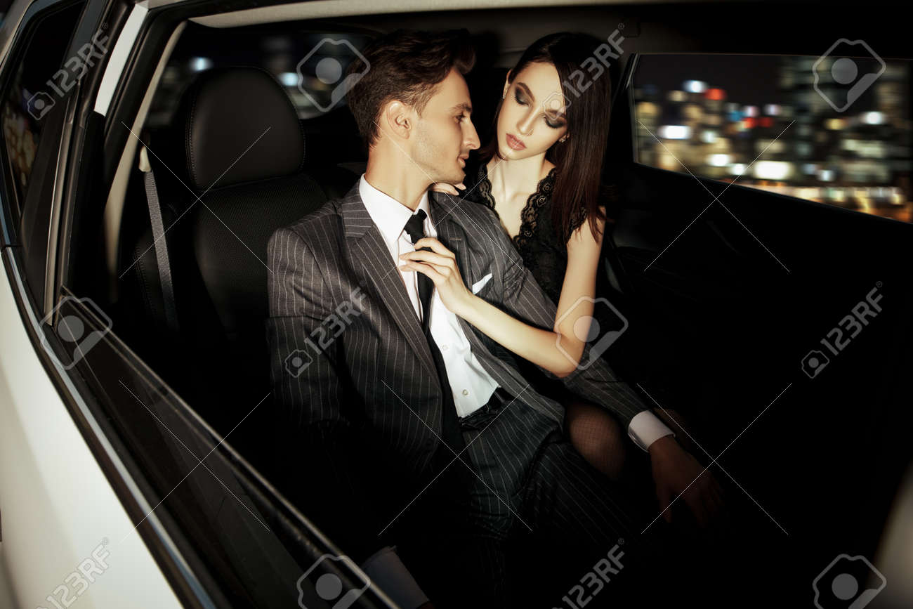 Glamorous passionate couple in a car. Beauty, fashion. - 152702639