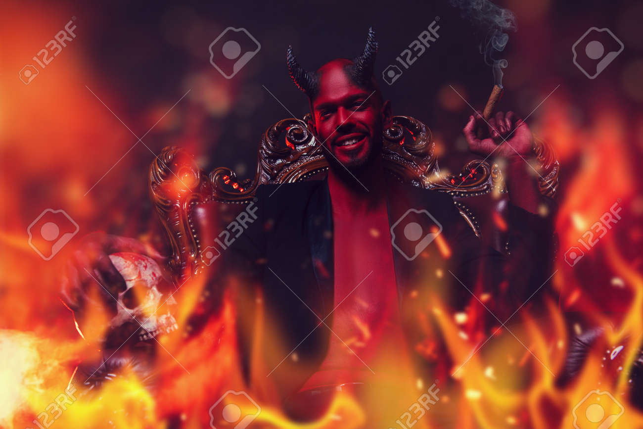 A portrait of a bad demon in his throne with a skull and cigar in fire. Horror movie, nightmare. Halloween. - 155515408