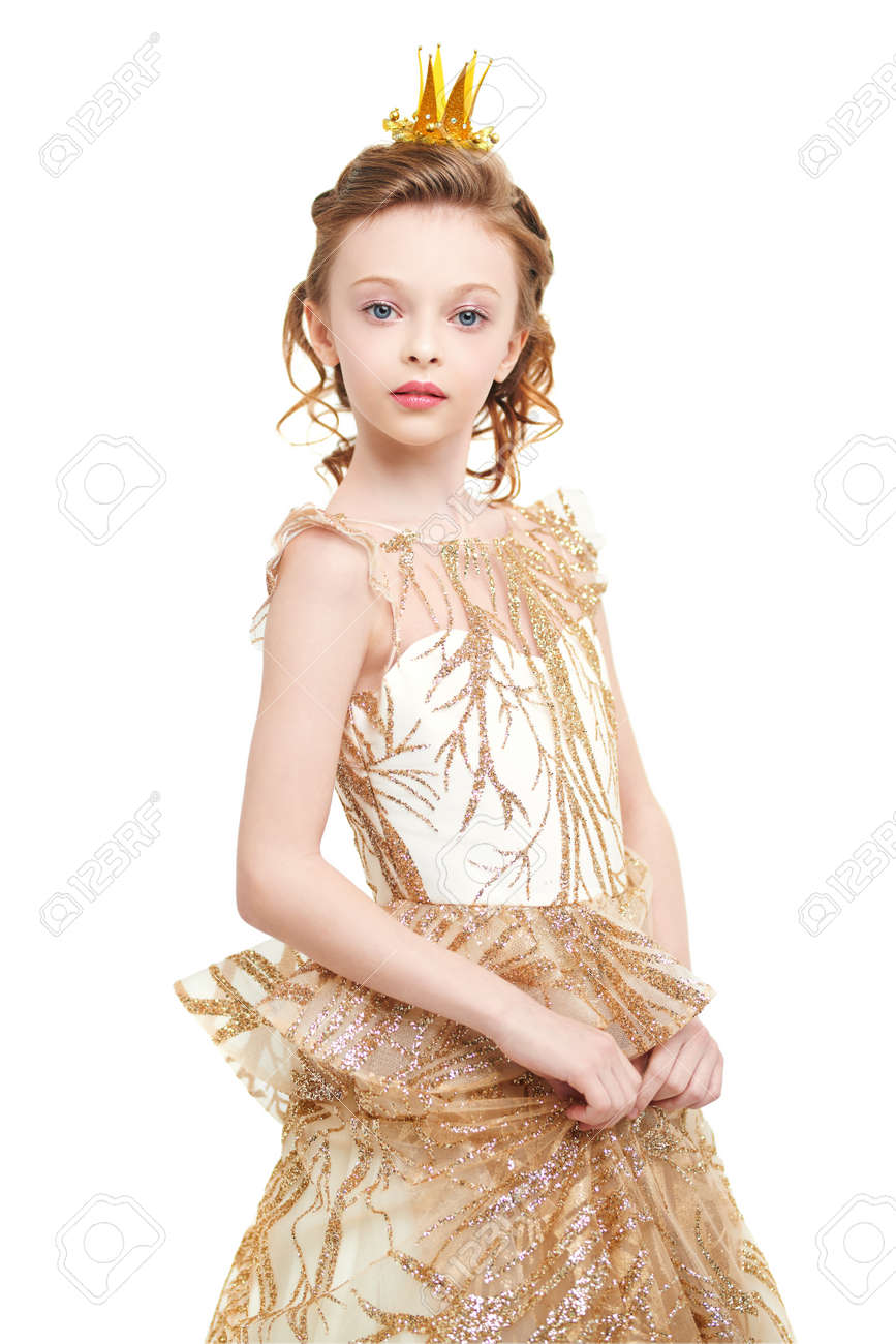 Portrait of a beautiful little princess girl in a golden dress and a crown on a white background. Childhood dreams. Fairy tales. - 167691046