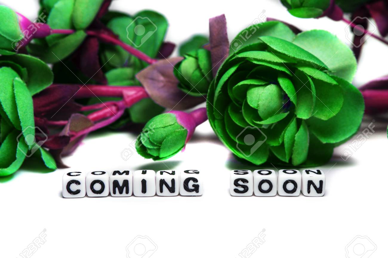Coming Soon Message With Dark Green Colored Flowers On White Stock