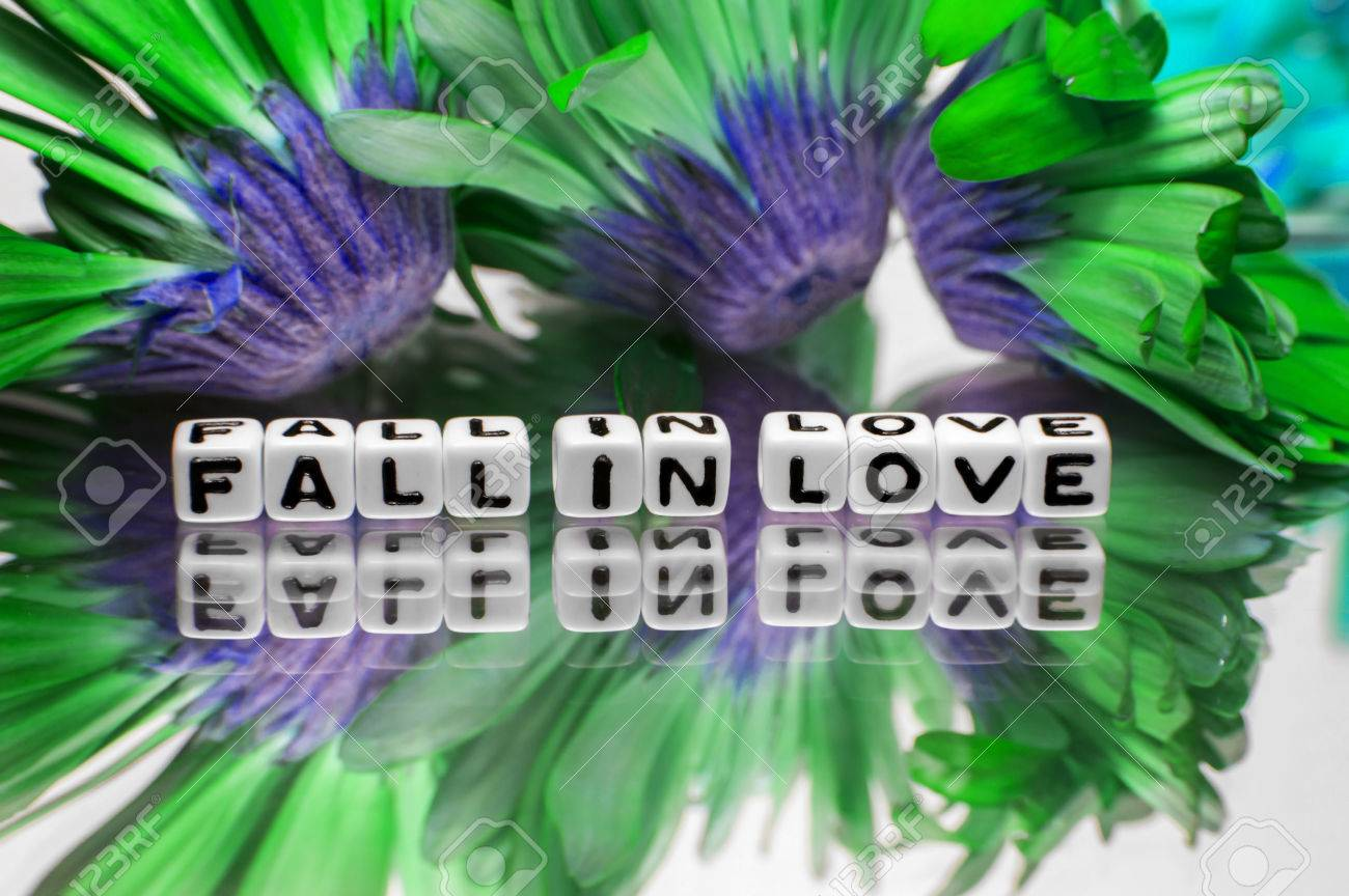 Fall In Love Message With Green And Blue Flowers Stock Photo